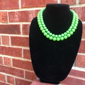 Double stranded green bead necklace
